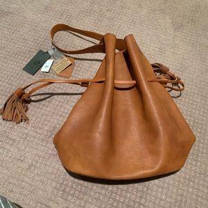 Tan bucket Francesca's purse